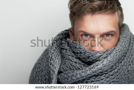 Close up portrait of an attractive face covered by scarf - stock photo