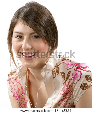 Close up portrait of an attractive joyful woman listening to music with her headphones, isolated against a white background. - stock photo