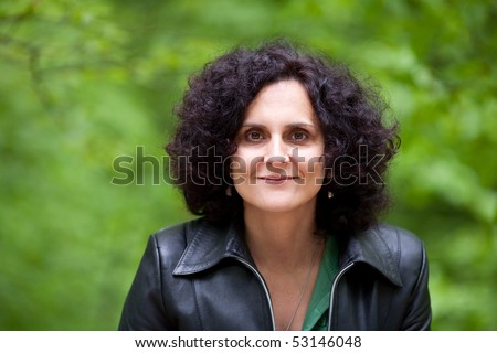 Close up portrait of an attractive lady with curly hair outdoor
