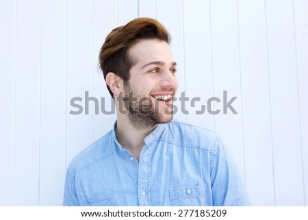 Close up portrait of an attractive man smiling on white background - stock photo