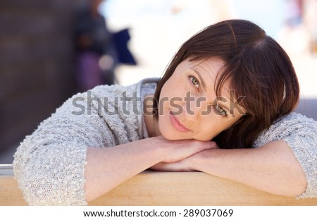 Close up portrait of an attractive older woman relaxing - stock photo