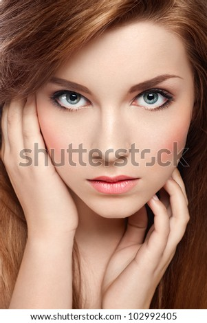 Close-up portrait of an attractive red-haired girl - stock photo