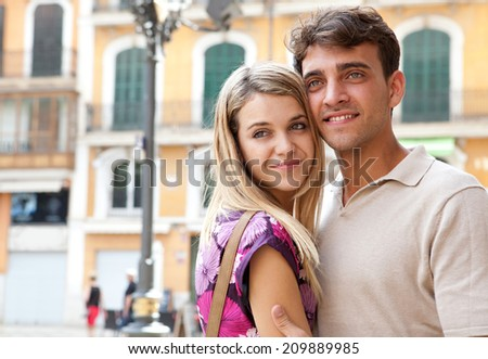 Close up portrait of an attractive romantic young couple relaxing and embracing while visiting a destination city on holiday together, outdoors. (Love, Lifestyle, outdoor)