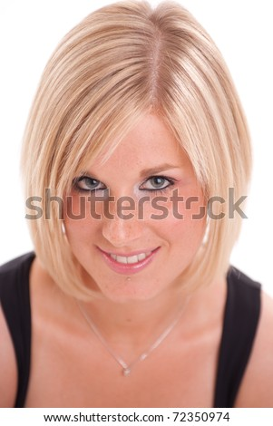 Close-up portrait of an attractive smiling blonde woman - stock photo