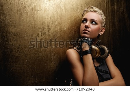 Close-up portrait of an attractive steam punk girl with headphones - stock photo