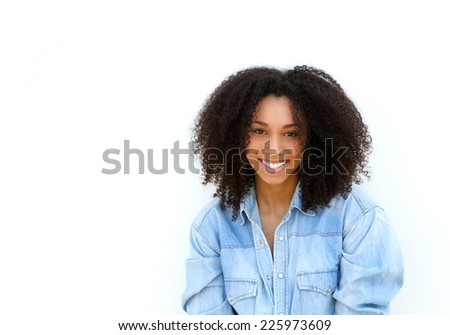 Close up portrait of an attractive young black woman with curly hair smiling on isolated white background - stock photo