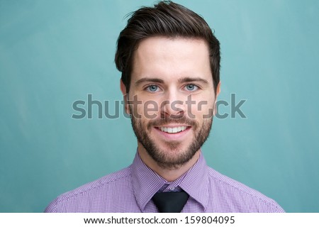 Close up portrait of an attractive young businessman smiling - stock photo