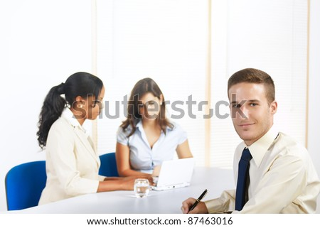 Close up portrait of an attractive young Caucasian businessman. - stock photo