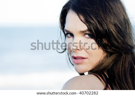 Close up portrait of an attractive young woman - stock photo