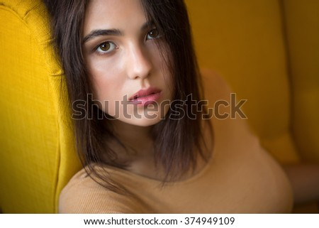 Close-up portrait of an attractive young woman smiling - stock photo