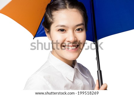 Close up portrait of an attractive young woman under umbrella on white background. - stock photo
