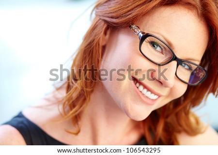 Close-up portrait of an elegant business lady wearing eyeglasses - stock photo