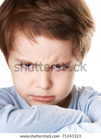 Close-up portrait of angry little boy isolated on white background - stock photo