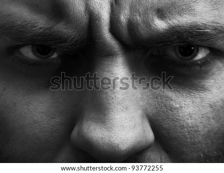 Close-up portrait of angry man. In B/W - stock photo