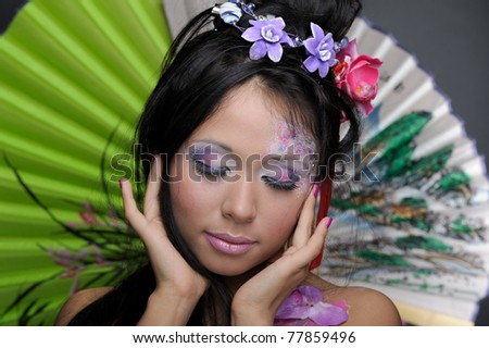 Close-up portrait of asian beauty girl with floral make-up