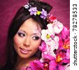 Close-up portrait of asian beauty girl with flowers - stock photo
