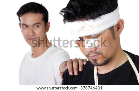 Close up portrait of Asian man with beaten up face, and a friend lays hand on his shoulder, isolated on white background - stock photo