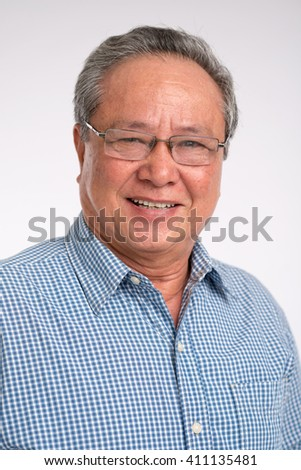 Close-up portrait of Asian smiling mature man in glasses