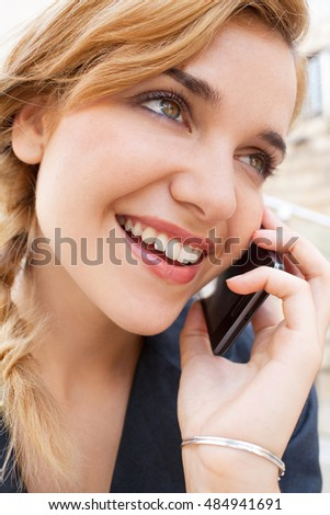 Close up portrait of aspirational young beautiful smiling business woman using smart phone, speaking in phone call conversation, outdoors. Professional girl using technology, lifestyle exterior.