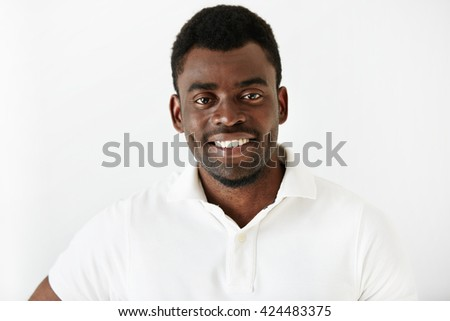 Close up portrait of attractive African American office worker looking at the camera with happy and cheerful expression while relaxing at home after hard working day in the office. Body language - stock photo