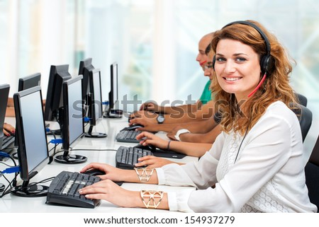 Close up portrait of attractive female student in training course. - stock photo