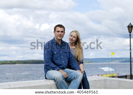 Close up portrait of attractive girl embracing her boyfriend outdoors.  - stock photo
