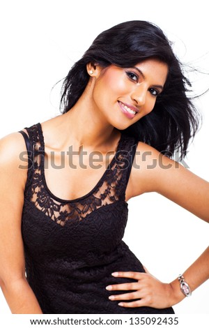close up portrait of attractive indian woman posing over white background - stock photo