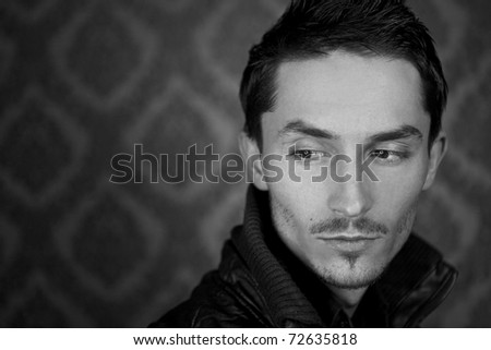 Close-up portrait of attractive man with deep sight. Black-white photo. - stock photo