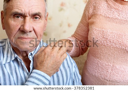 Close up portrait of attractive senior man looking directly at the camera - stock photo