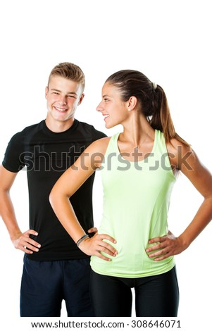Close up portrait of attractive teen couple in sportswear ready for fitness workout.Isolated on white background. - stock photo