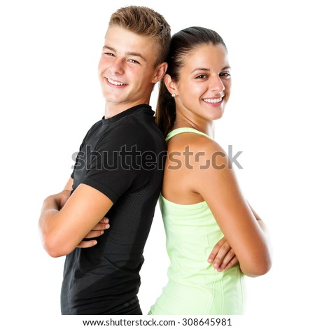 Close up portrait of attractive teen couple in sportswear standing back to back.Isolated on white background. - stock photo