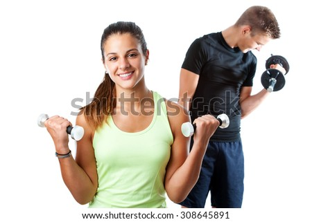 Close up portrait of attractive teen girl doing aerobic workout with boy in background. Isolated on white background. - stock photo