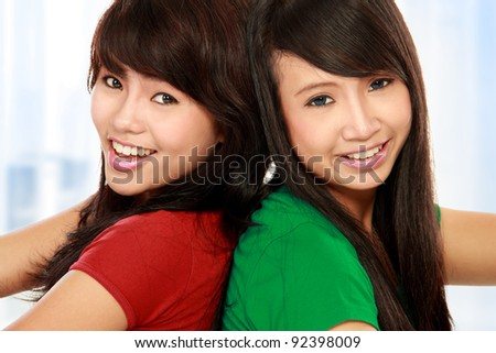 close up portrait of attractive two teenage girls having fun - stock photo