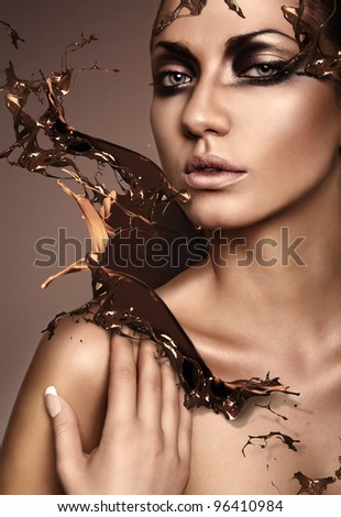close up portrait of attractive woman with chocolate splash - stock photo