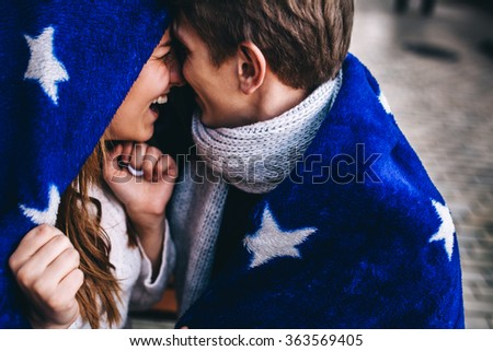 Close up portrait of attractive young couple playing outdoors. - stock photo