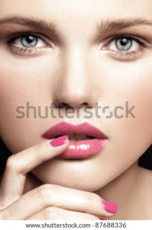 close-up portrait of attractive young model with bright make-up and manicure - stock photo