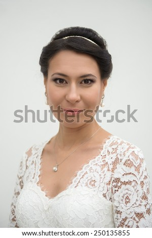 close up portrait of attractive young woman in a white wedding dress - stock photo