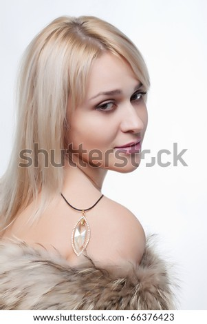 Close up portrait of attractive young woman with a fur scarf isolated on a white background