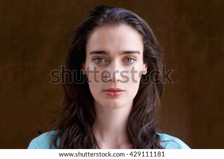 Close up portrait of attractive young woman with long hair  - stock photo