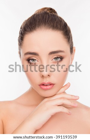 Close up portrait of attrective beautiful sensitive girl touching her chin - stock photo