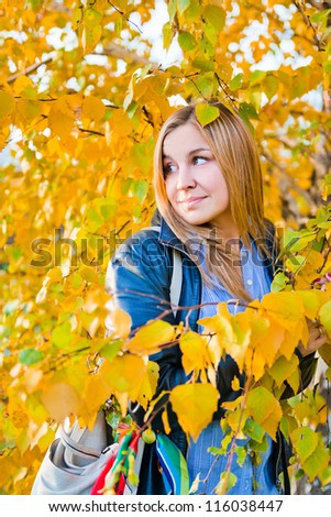 close up portrait of autumn woman with yellow leaves