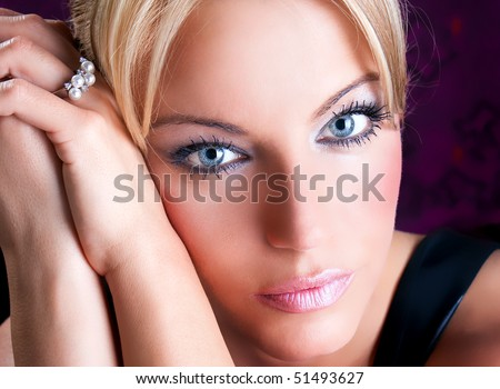 Close up portrait of beautiful  adult woman with blue eyes , studio shot - stock photo