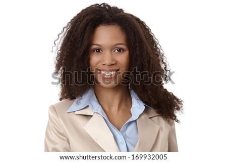 Close-up portrait of beautiful afro-american businesswoman smiling. - stock photo