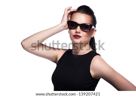 close-up portrait of beautiful and fashion girl in sunglasses, studio shot