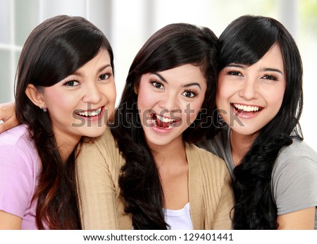 close up portrait of beautiful asian woman smiling together - stock photo