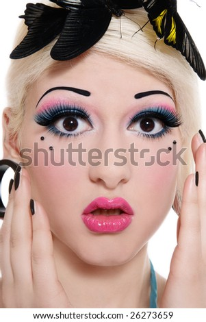 Close-up portrait of beautiful blond scared girl with bright makeup and three tropical butterflies on her head - stock photo