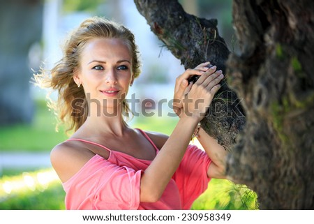 Close-Up Portrait Of Beautiful Blonde Smiling Woman - stock photo