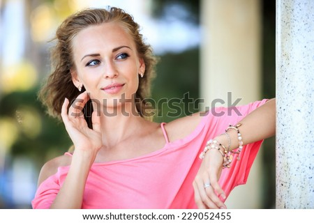 Close-Up Portrait Of Beautiful Blonde Woman Looking Away - stock photo