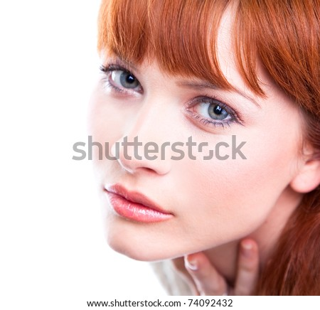 Close-up portrait of beautiful caucasian young woman with blue eyes - stock photo