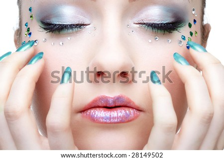 Close-up portrait of beautiful caucasian young woman with pearl glamour make-up and blue nails manicure
